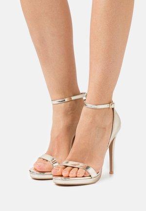 REAGAN - Sandaler med høye hæler - gold