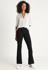 JDY - JDYCIM FLARED PANT - Leggings - Trousers - black - 1