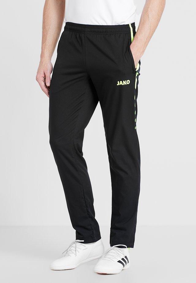 STRIKER - Pantalones deportivos - schwarz/neongelb