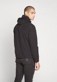 Calvin Klein - CRINKLE HOODED WINDCHEATER - Summer jacket - black - 2