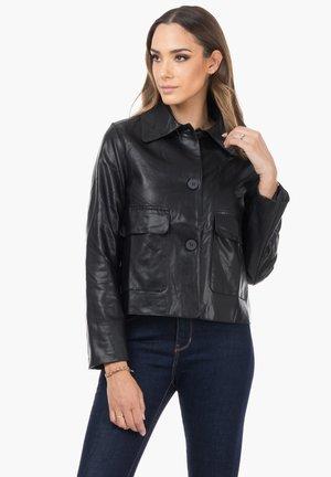 GEKNÖPFTE - Faux leather jacket - black