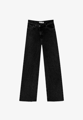MIT ASYMMETRISCHEM BUND  - Straight leg jeans - black