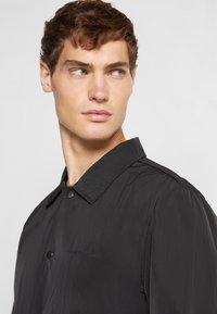 GARMENT PROJECT - COACH - Lehká bunda - black - 4