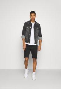 Tommy Jeans - REGULAR TRUCKER - Denim jacket - grey - 1