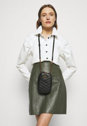 KIRA CHEVRON CROSSBODY - Across body bag - black