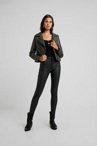 Vero Moda - VMSOPHIA COATED PANTS - Trousers - black - 1