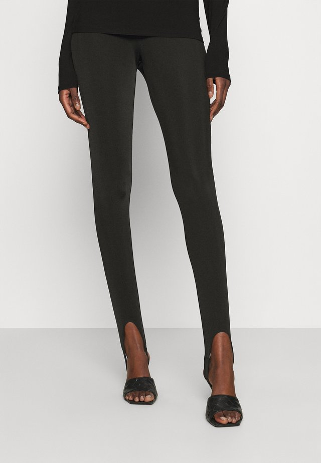 RINGO - Leggingsit - black