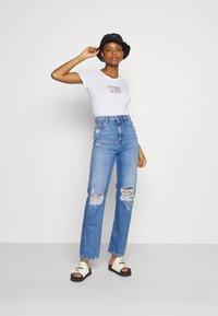Tommy Jeans - JULIE UHR - Straight leg jeans - denim light - 1