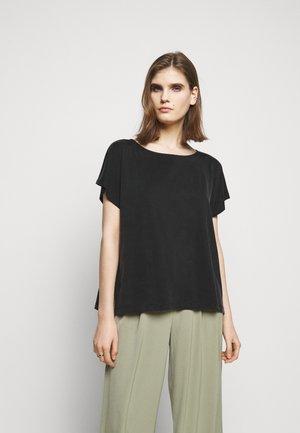KIMANA - Basic T-shirt - schwarz