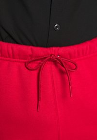 Jordan - JUMPMAN AIR  - Tracksuit bottoms - gym red/black - 4