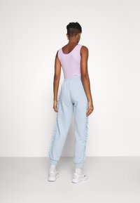 ONLY - ONLAVA FRILL  - Tracksuit bottoms - blue - 2