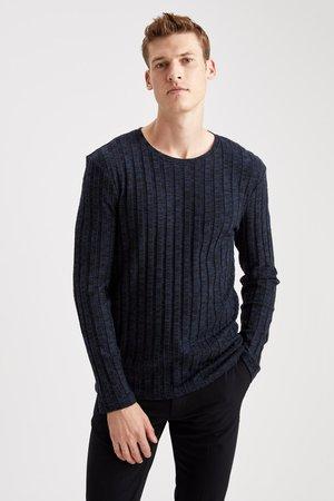 Stickad tröja - indigo