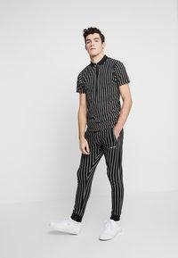 Nominal - GHAZNI - Teplákové kalhoty - black - 1
