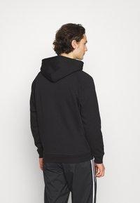 adidas Originals - TREFOIL HOOD UNISEX - Sweatshirt - black - 2