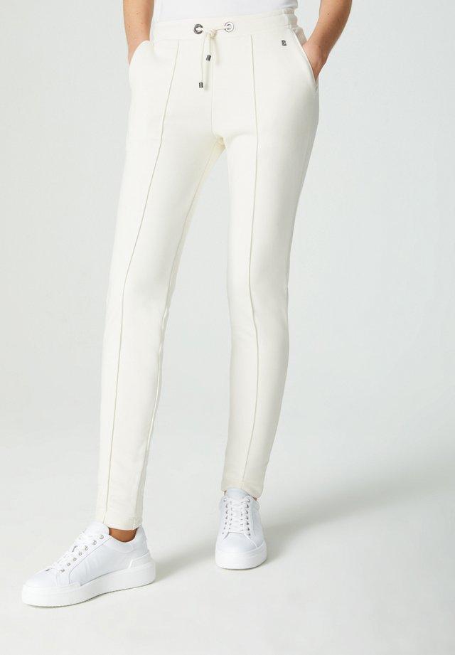 CARA - Teplákové kalhoty - creme