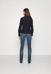 G-Star - 3301 MID BOOTLEG - Jeans bootcut - medium indigo - 2