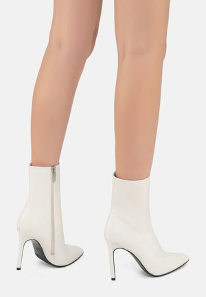 High heeled ankle boots - milk
