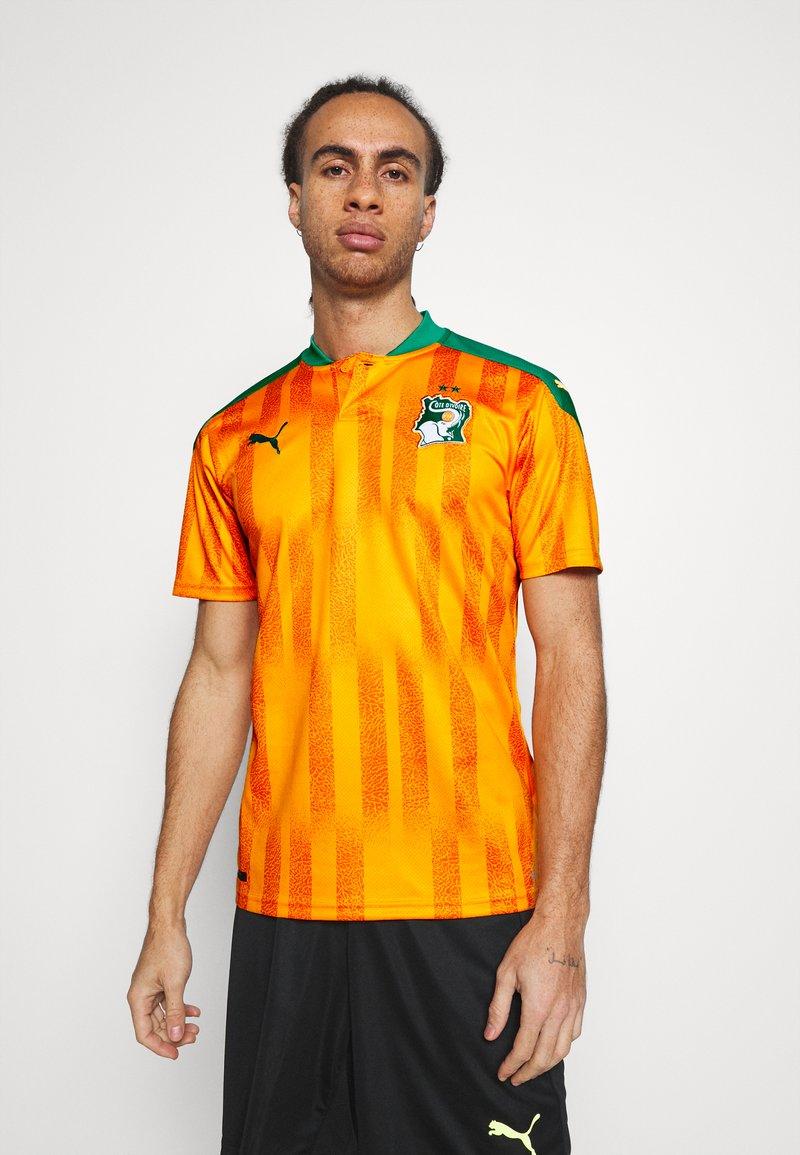 Puma - ELFENBEINKÜSTE FIF HOME SHIRT REPLICA - National team wear - flame orange/pepper green