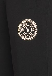 Versace Jeans Couture - Tracksuit bottoms - nero - 8