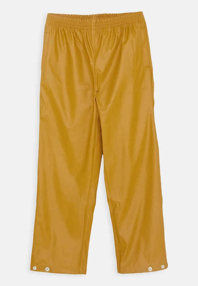 HIDDEN DRAGON UNISEX - Rain trousers - inca gold