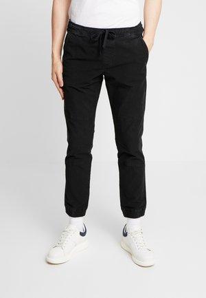 JOGGERFIT - Trousers - black