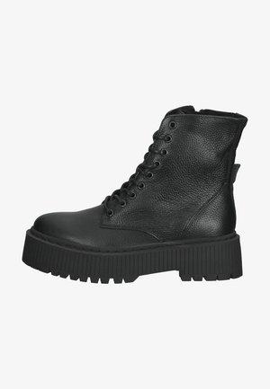 Enkellaarsjes met plateauzool - black leather