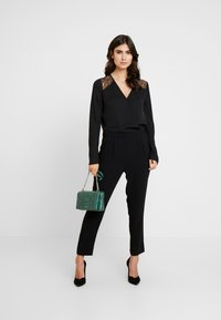 comma - CATSUIT - Jumpsuit - black - 1