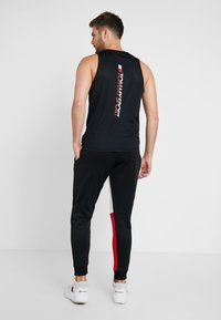 Tommy Sport - GRAPHIC LOGO CUFF - Tracksuit bottoms - black - 2