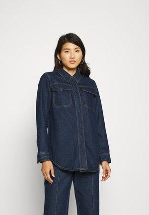 THE AFTER DARK SHIRT - Button-down blouse - dark-blue denim