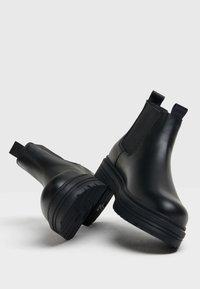 Bershka - Kotníkové boty - black - 2