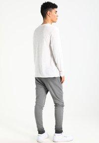 YOURTURN - Spodnie treningowe - black - 2