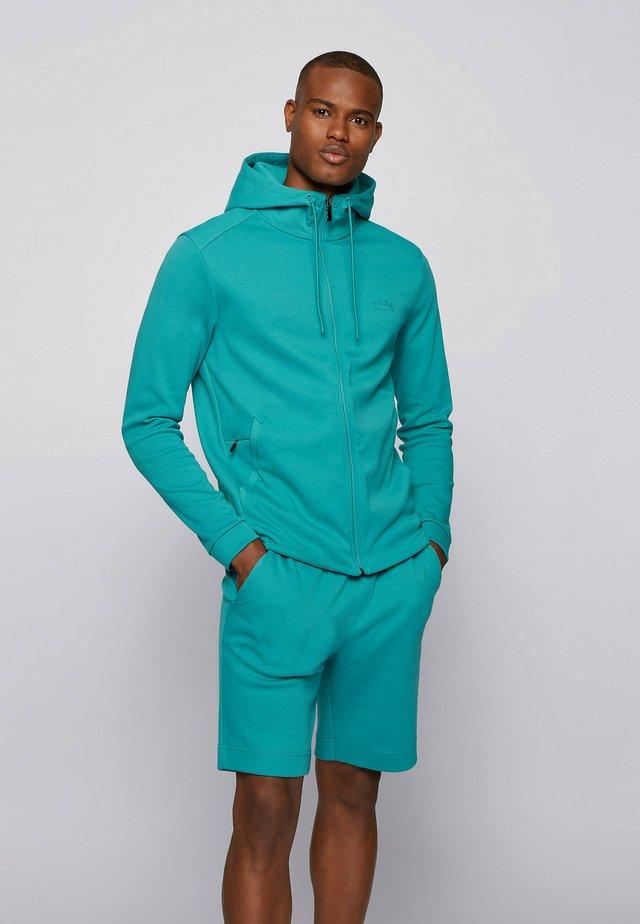 SAGGY - veste en sweat zippée - turquoise