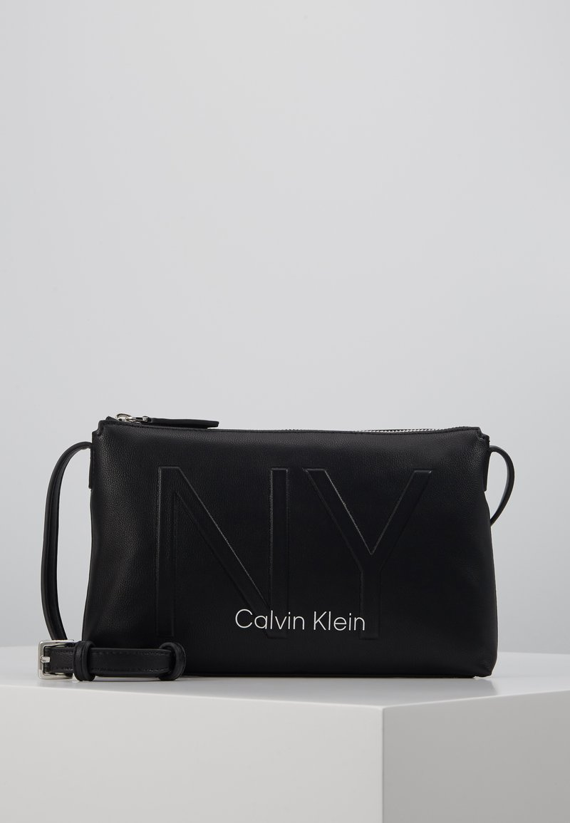 Calvin Klein - SHAPED CROSSBODY - Across body bag - black