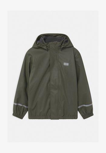 JIPE UNISEX - Waterproof jacket - dark green