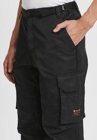 Timberland - ECORIGINAL EK - Cargo trousers - black - 2