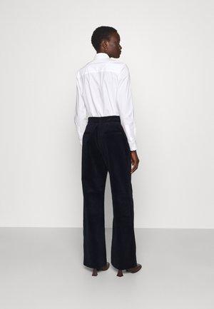 LEA PANTS - Trousers - navy
