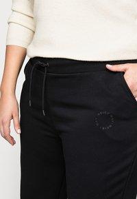 Noisy May Curve - NMLUPA LOGO PANTS - Tracksuit bottoms - black - 4