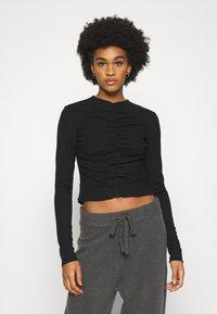 Monki - RUCHIE - Long sleeved top - black - 0