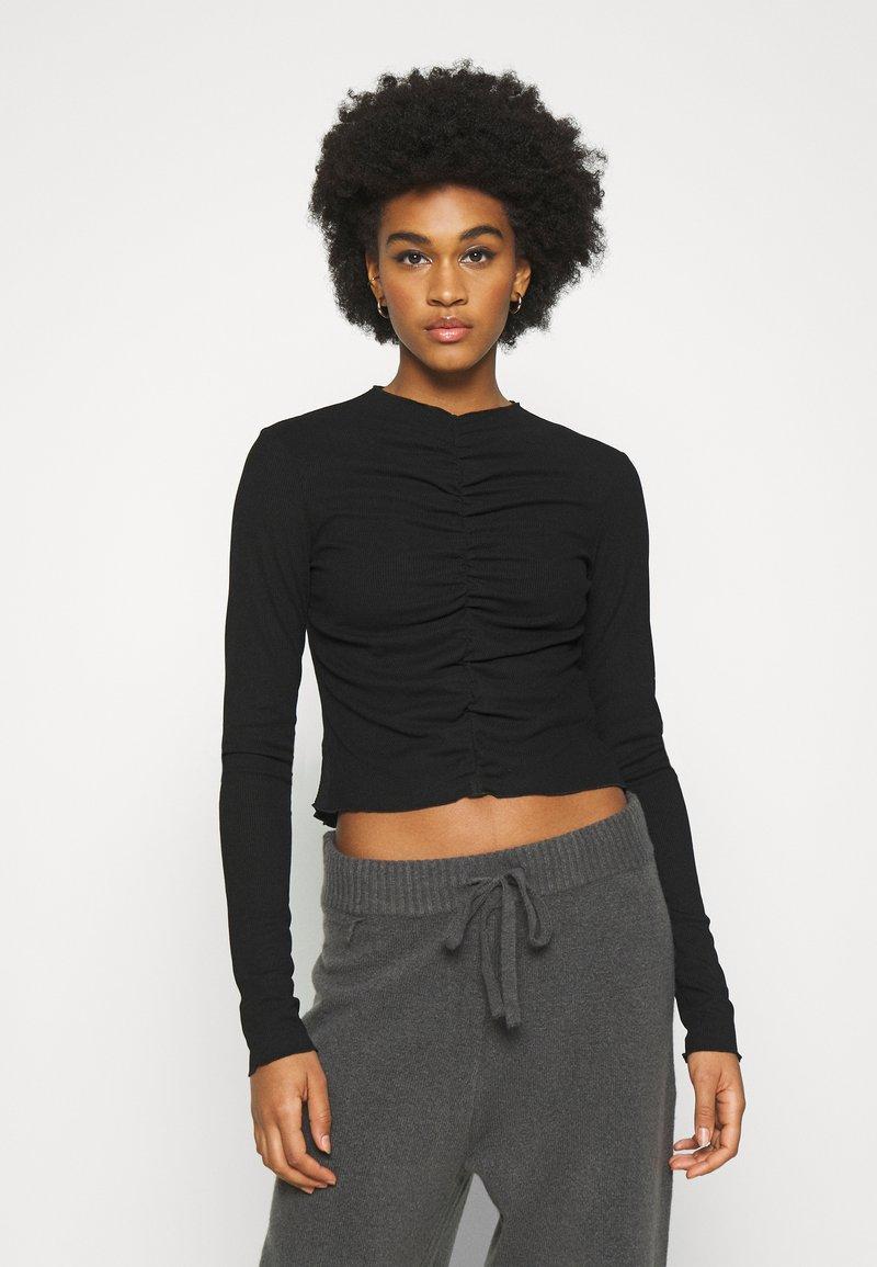 Monki - RUCHIE - Long sleeved top - black