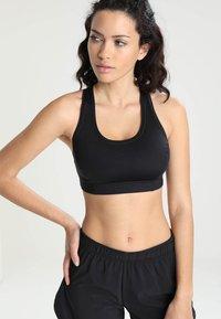 Casall - ICONIC SPORTS BRA - Medium support sports bra - black - 0