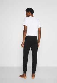 Diesel - UMLB-JULIO PANTALONI - Pyjama bottoms - black - 2