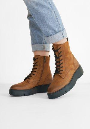 Platform ankle boots - cognac-braun 017