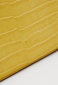 s.Oliver - Across body bag - yellow - 2