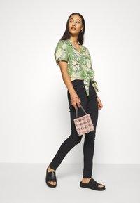 Ivy Copenhagen - ALEXA ANKLE COOL - Jeans Skinny Fit - black - 1