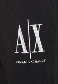 Armani Exchange - PANTALONI - Tracksuit bottoms - black - 2