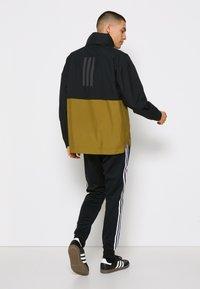 adidas Performance - URBAN RAIN.RDY - Regnjacka - black/wild moss - 2