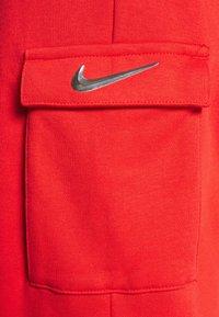 Nike Sportswear - PANT - Tracksuit bottoms - crimson/black - 6