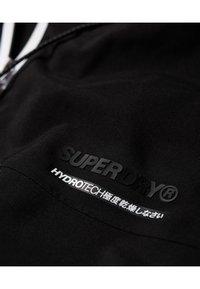 Superdry - HARPA - Waterproof jacket - black - 4