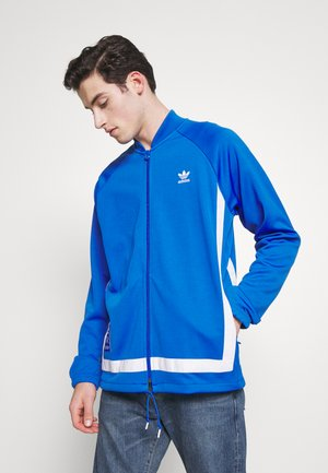 WARMUP - Training jacket - blue/white