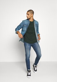 Tommy Jeans - SIMON - Jeans Skinny Fit - dark blue denim - 1